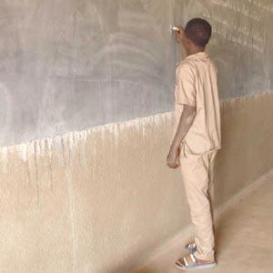 Elève du collège de Guiè au Burkina Faso au tableau noir