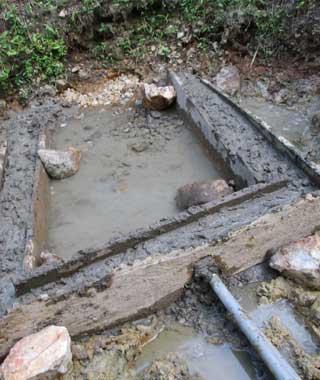 Construction d'un bassin de décantation des eaux pour l'aménagement d'une source d'eau potable à Kabweke au Nord Kivu en RDC